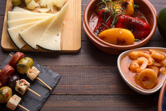 Spanish tapas starters on wooden table Royalty Free Stock Image