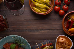 Spanish tapas starters on wooden table Stock Image