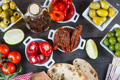 Spanish tapas on wooden rustic table from above Stock Images