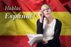 Spanish. Teacher in front of the  flag Stock Photo