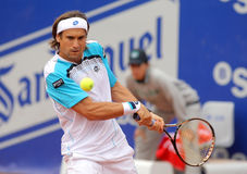 Spanish tennis player David Ferrer. In action during his match against Gimeno-Traver of   Barcelona tennis tournament Conde de Godo on April 20, 2011 in Royalty Free Stock Image