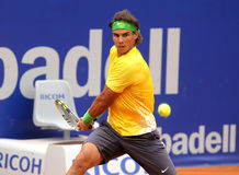 Spanish tennis player Rafa Nadal. Spanish tennis player Rafael Nadal in action during his match against Gimeno-Traver of   Barcelona tennis tournament Conde de Stock Image