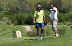 Rafa Nadal playing golf with his uncle. Spanish tennis top player Rafa Nadal and his uncle former Barcelonas soccer player Miguel Angel Nadal play golf in the Royalty Free Stock Photo