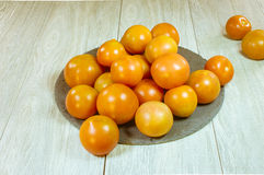 Tomato. Es on the table , ecological, freshly collected from the fieldreshly picked organic es field Royalty Free Stock Photography