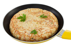 Spanish tortilla on frying pan Stock Images