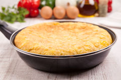 Spanish tortilla (omelette) in the frying pan Royalty Free Stock Photos