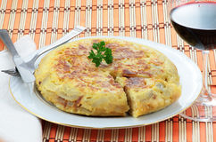 Spanish tortilla with potatoes and onion. Spanish omelet of potatoes and onion with a glass of red wine Stock Photography