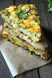 Spanish tortilla with slices of fresh greens Stock Photo