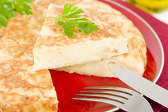 Spanish Tortilla. Traditional Spanish omelette made with potatoes and fried in olive oil Royalty Free Stock Images