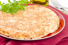 Spanish Tortilla. Traditional Spanish omelette made with potatoes and fried in olive oil Stock Image