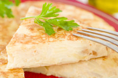 Spanish Tortilla. Traditional Spanish omelette made with potatoes and fried in olive oil Stock Photos