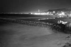 Spanish Town on the Coast in Black and White. Spanish costal town of Malaga at night in black and white Stock Image