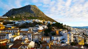 Spanish town, Martos with a mountain and white houses. Blue cloudy sky and red tiled roof Royalty Free Stock Photos