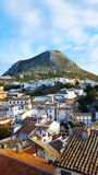 Spanish town, Martos with a mountain and white houses. Blue cloudy sky and red tiled roof Royalty Free Stock Photo