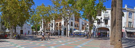 Spanish town square panorama. Square Plaza de Balcon de Europa offering view to a busy seaside town piazza Royalty Free Stock Photo