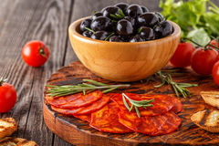 Spanish traditional chorizo sausage with fresh herbs, olives Stock Image