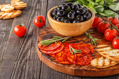 Spanish traditional chorizo sausage with fresh herbs, olives Stock Photo