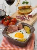 Spanish traditional dish fried eggs with serrano ham and potatoe Stock Image