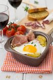 Spanish traditional dish fried eggs with serrano ham and potatoe Royalty Free Stock Image