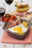 Spanish traditional dish fried eggs with serrano ham and potatoe Royalty Free Stock Image