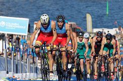 Spanish triathlon competitors cycling uphill Royalty Free Stock Photos