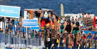 Spanish triathlon competitors cycling uphill Royalty Free Stock Image