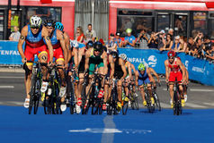 Spanish triathlon competitors cycling uphill Stock Photography