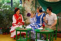 Spanish TV presenters. Spanish TV presenters wearing flamenco dresses in a studio in the park during the Romeria San Bernabe festival, Marbella, Costa del Sol Stock Photography