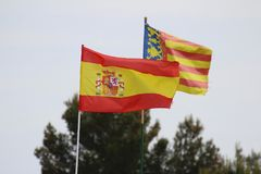The Spanish and Valencia flags flying side by side Stock Image