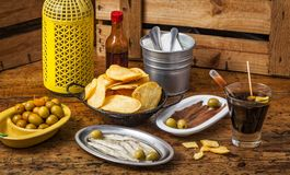 Spanish vermouth with tapas on a vintage wooden table. royalty free stock photography