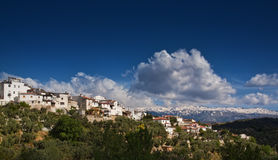 Spanish village. Scenic view of Spanish village on hillside with blue sky and cloudscape background, Andalusia, Spain Stock Photography