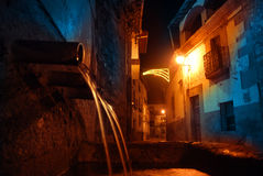 Spanish village at Christmas. At Christmas times.  night view of Cuacos de Yuste,Caceres, Spain, the village where the emperor Charles V died. A natural fountain Royalty Free Stock Image