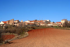 Spanish village and a field Royalty Free Stock Photo