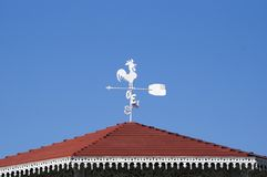 Spanish Weather Vane. Atop a gazebo in rural Mexico against a blue sky royalty free stock photo