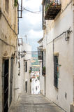 Spanish White Hilltop Town Street. A street in the Spainish white hilltop town of Arcos de la Frontera Stock Photos