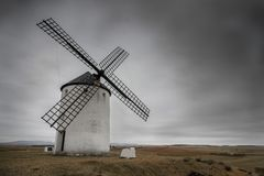 Spanish windmill typical from La Mancha in a cloudy day Royalty Free Stock Image