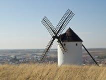 Spanish Windmill. Typical spanish windmill on the top of a hill in the area of La Mancha, where Miguel de Cervantes wrote his famous book Don Quixote de la Stock Photos