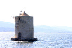 Spanish windmill in the lake of Orbetello, Italy Stock Photos