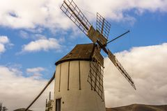 Spanish windmill made of stone with blue sky Stock Photo