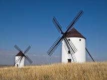 Spanish Windmills. Two typical spanish windmills in the area of La Mancha, where Miguel de Cervantes wrote his famous book Don Quixote de la Mancha Royalty Free Stock Images