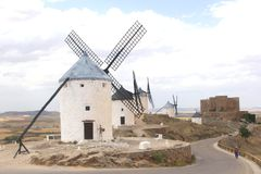 Picturesque Spanish windmills and Don Quichot statue in Consuegra,Spain Royalty Free Stock Image