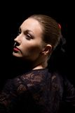 Spanish woman. Portrait of attractive spanish woman over black background Stock Image