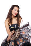 Spanish  woman behind traditional fan. Royalty Free Stock Photos