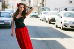 Spanish woman in black dress is posing in the town Stock Photography