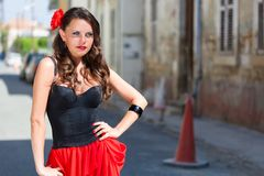 Spanish woman in black dress is posing in the town Royalty Free Stock Photo