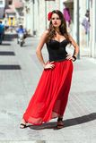 Spanish woman in black dress is posing in the town Stock Image
