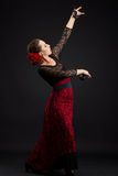 Spanish woman dancing flamenco on black Royalty Free Stock Image