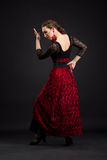 Spanish woman dancing flamenco on black Royalty Free Stock Photos