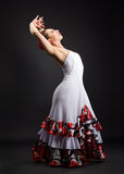 Spanish woman dancing flamenco on black Royalty Free Stock Images