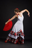 Spanish woman dancing flamenco on black Royalty Free Stock Photo